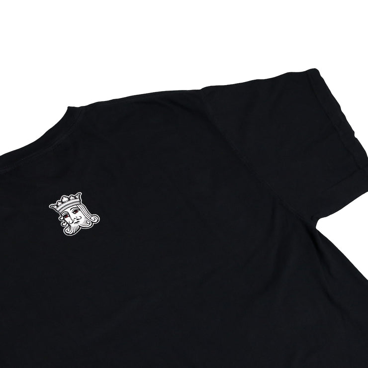 The back of the Kingpen Heritage Collection Our Menu Shirt with small King Head icon centered on shirt and close to collar.