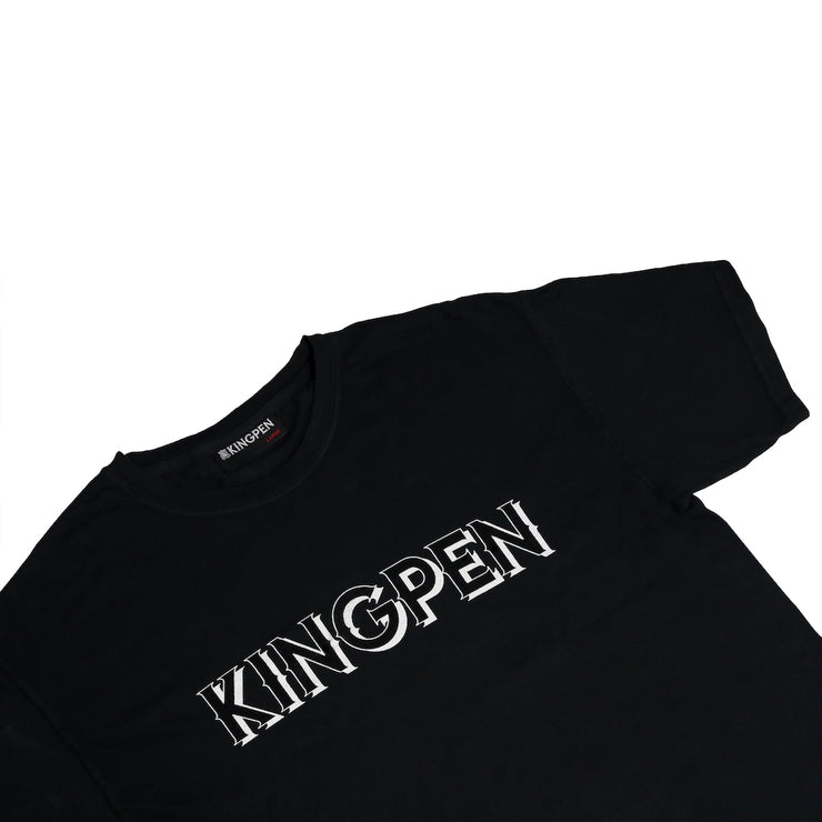 A closer look at the front of the Kingpen Heritage Collection Our Menu Shirt, featuring 3D design on Kingpen Wordmark. Also displays Kingpen clothing tag on inside of collar.