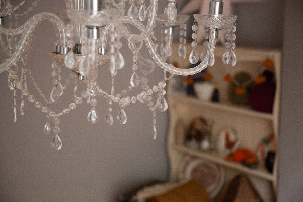 """alt=""""ariel view of chandelier with cream dresser in background. Image available at Bramble and Fox UK hygge home blog"""""""