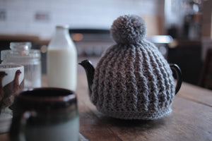 soft grey hand crochet chunky knit tea cosy with pom pom made by Rosie and Max Crafts