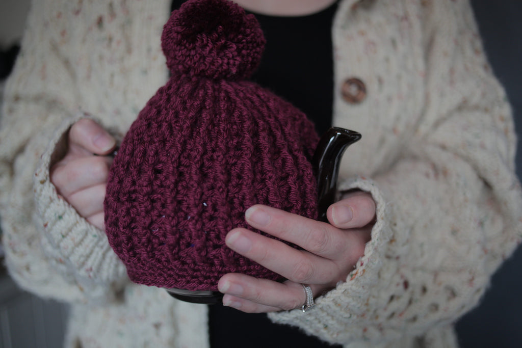 claret hand crochet chunky knit tea cosy with pom pom made by Rosie and Max Crafts