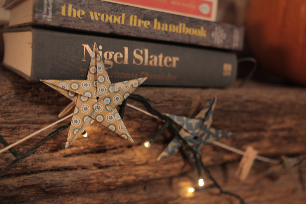 handmade paper origami lucky star garland with pegs by Raine and Son. Perfect for Scandi interiors.