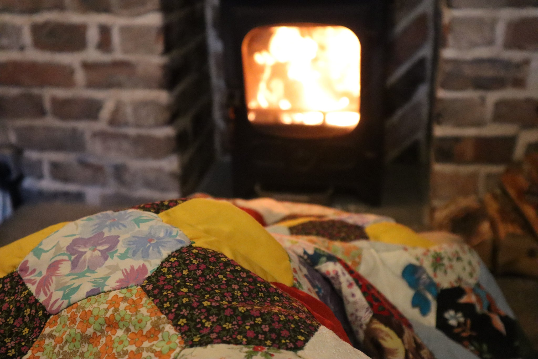cottagecore interiors, bramble and fox uk hygge shop, patchwork blanket, woodburner