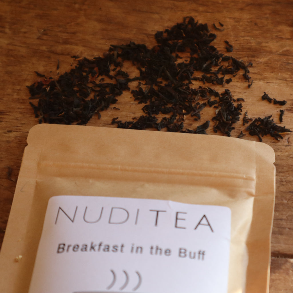 "alt=""nuditea breakfast in the buff loose leaf tea scattered on table by bramble and fox hygge gifts"""