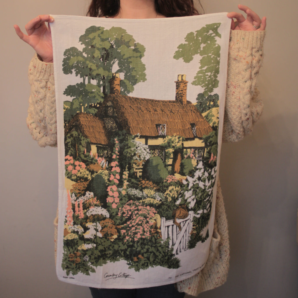 "alt=""thatched cottage national trust floral tea towel by lee kay available at bramble and fox uk hygge shop"""