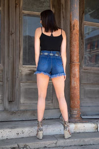 HIGH-RISE MID-WASH DENIM SHORT W/ FRINGE HEM