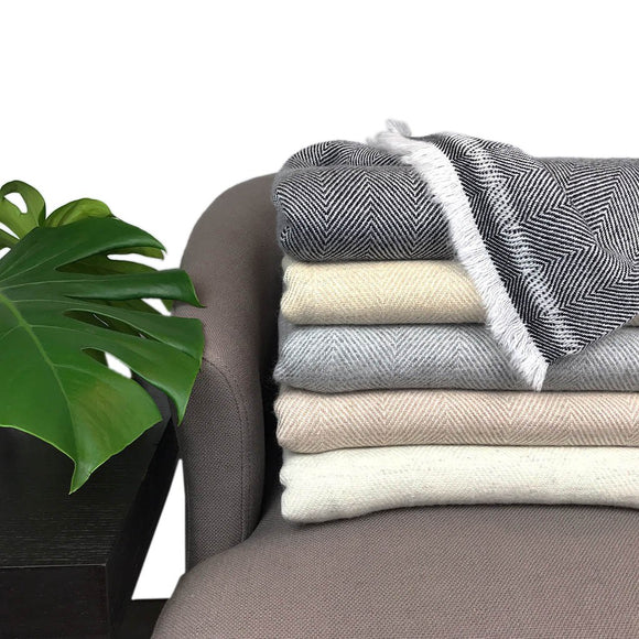 a collection of cashmere throws, herringbone cashmere throws  sabrina bitton designer toronto features her own on line store-shopsabrinabitton.com