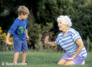 Granma and grandson playing on the grass