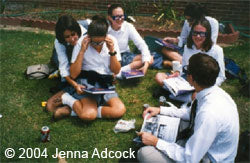 Signing yearbooks on the grass
