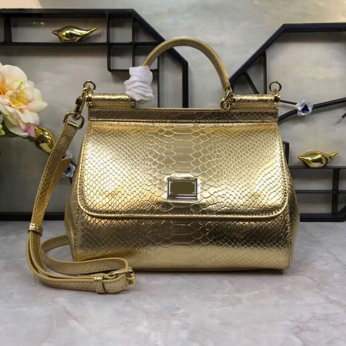 New fashionable medium-sized lady's handbag with oblique sling and golden cowhide Python and serpentine shoulder bag