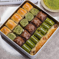 Traditional fresh delicious mixed Turkish baklava with pistachio and walnut. Dessert Baklava Turkish Famous Brand Baklava