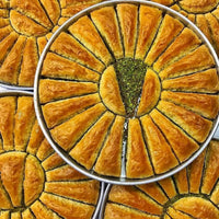 Traditional fresh delicious  Turkish Carrot Slice baklava with pistachio. Dessert Baklava Famous Brand Turkish Baklava pistachio