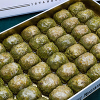 Traditional fresh delicious Turkish Dilber baklava with pistachio. Dessert Baklava Turkish Famous Brand pistachio Baklava