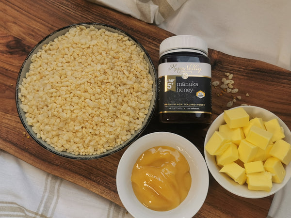 Ingredeinet for Rice Bubble Slice: rice bubbles in a bowl, UMF 5+ manuka & butter