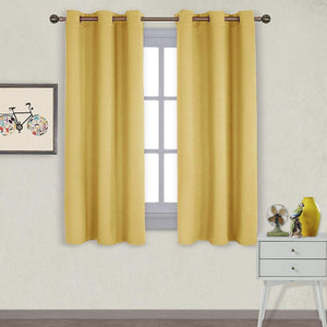 NICETOWN Triple Weave Microfiber Home Thermal Insulated Solid Ring Top Blackout Curtains/Drapes for Bedroom(Yellow, Set of 2, 42 x 63 Inch)
