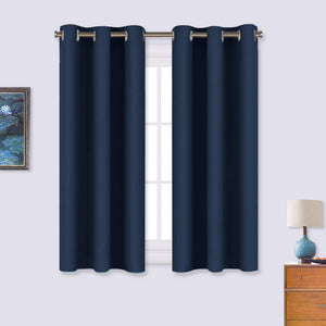 NICETOWN Blackout Curtain Panels, Window Treatment Energy Saving Thermal Insulated Solid Grommet Blackout Drapes/Draperies (Navy, 1 Pair, 34 by 54-inch)