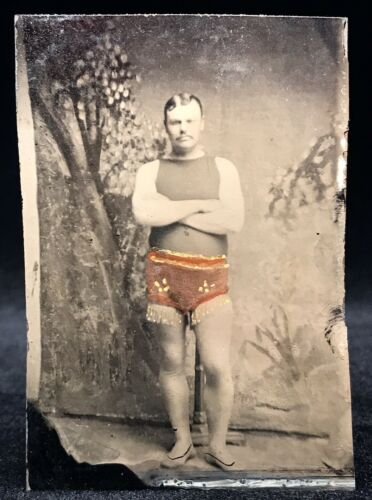 RARE OCCUPATIONAL TINTYPE - CIRCUS PERFORMER - ACROBAT IN TINTED FRINGED TRUNKS