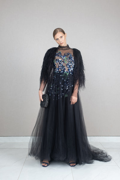 Feather accented embellished tulle gown