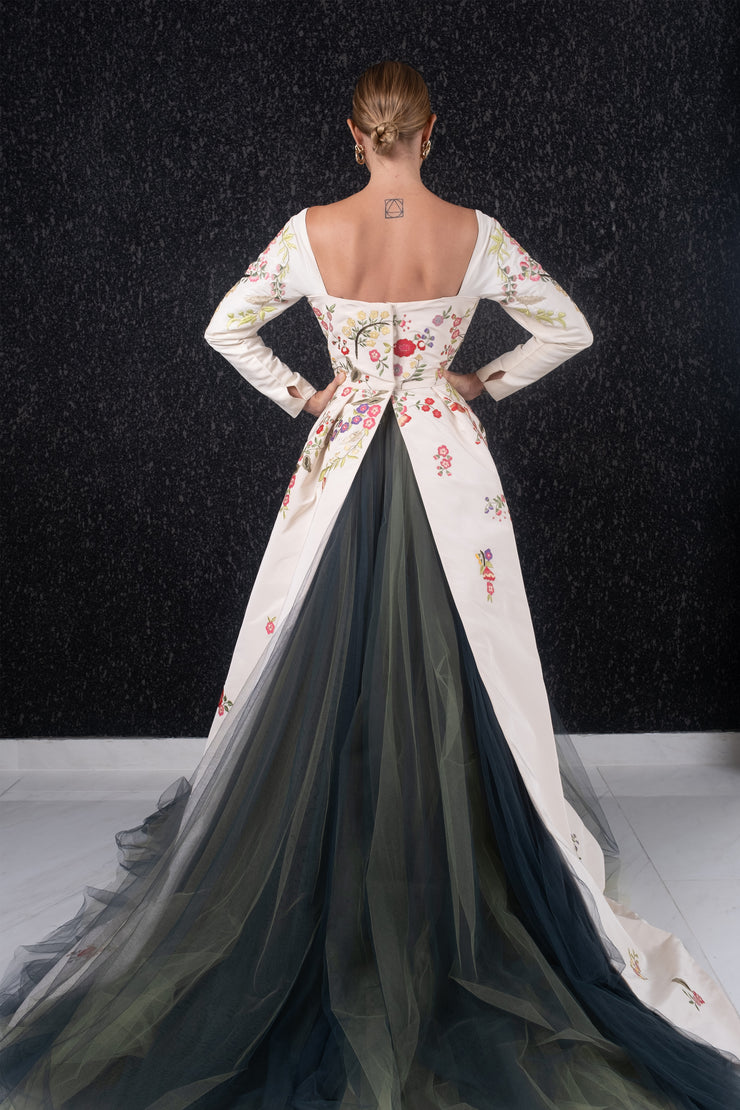 Long sleeve floral embroidered peplum train with tulle gown