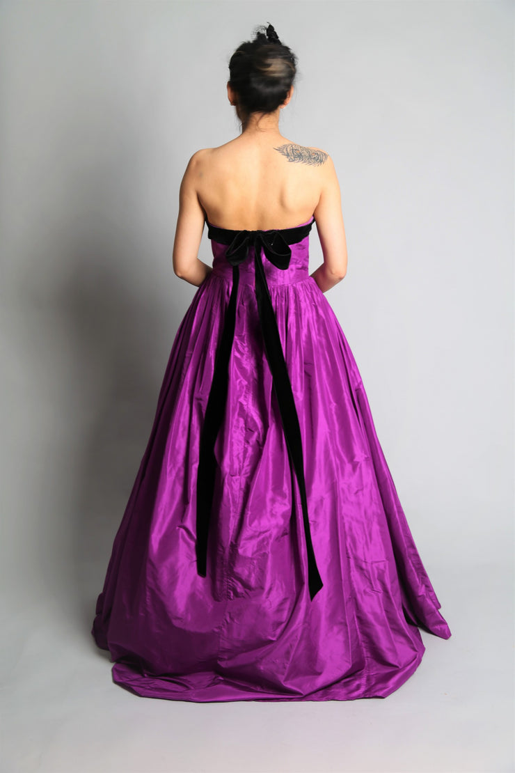 Strapless back bow tie taffeta gown
