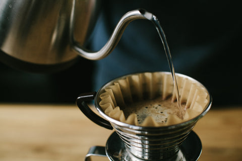 Pour over pours coffee