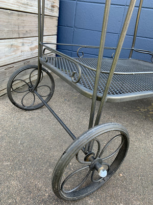 Vintage black metal garden cart on wheels. Heavy, rolls super smooth, top tray does remove
