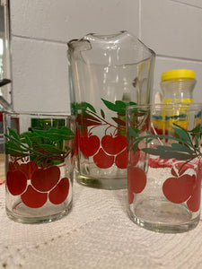 Cherry pitcher and two juice glasses