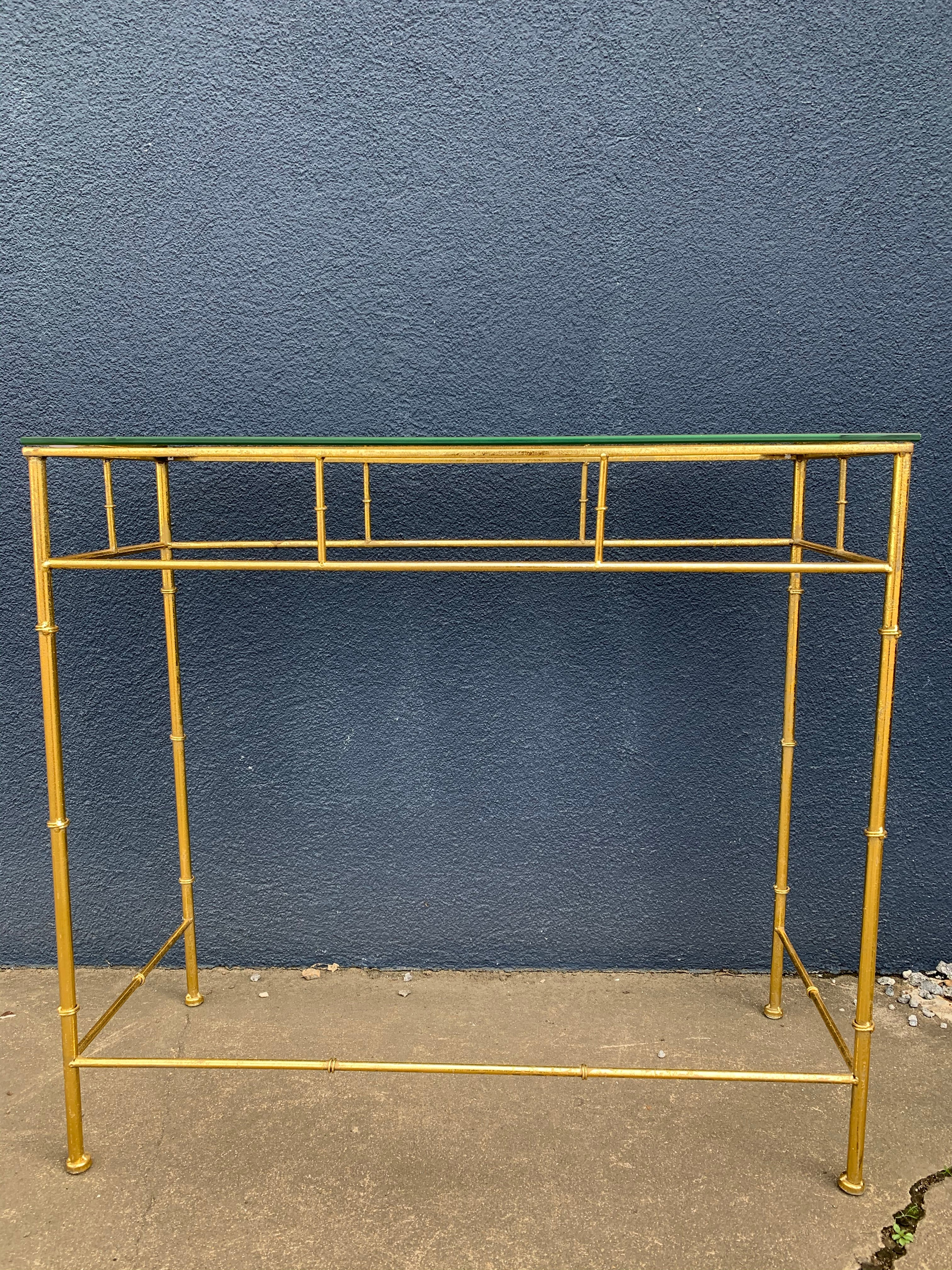 Brass finish foyer accent table with glass top