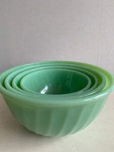 Set of four Fire King Jadeite swirl mixing bowls with original label