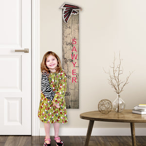 Personalized NFL Growth Chart in Livingroom with littler girl