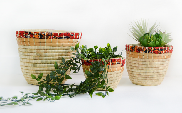 woven african baskets used as planters or storage. Fair trade and ethical handmade by refugees
