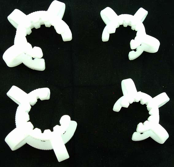 PAIR OF PLASTIC K-CLIPS FOR HOLDING GLASS ACCESSORIES.