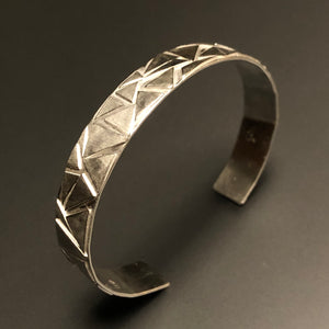 Play of triangles cuff