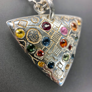 Silver and fancy multi-color sapphires trillion necklace