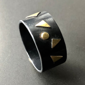 Triangles ring with 18K gold accents. Size 7.5