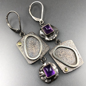 Asymmetrical amethyst earrings.