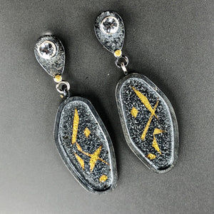 Japanese pattern earrings in 23.5K gold, sterling silver, and white topaz