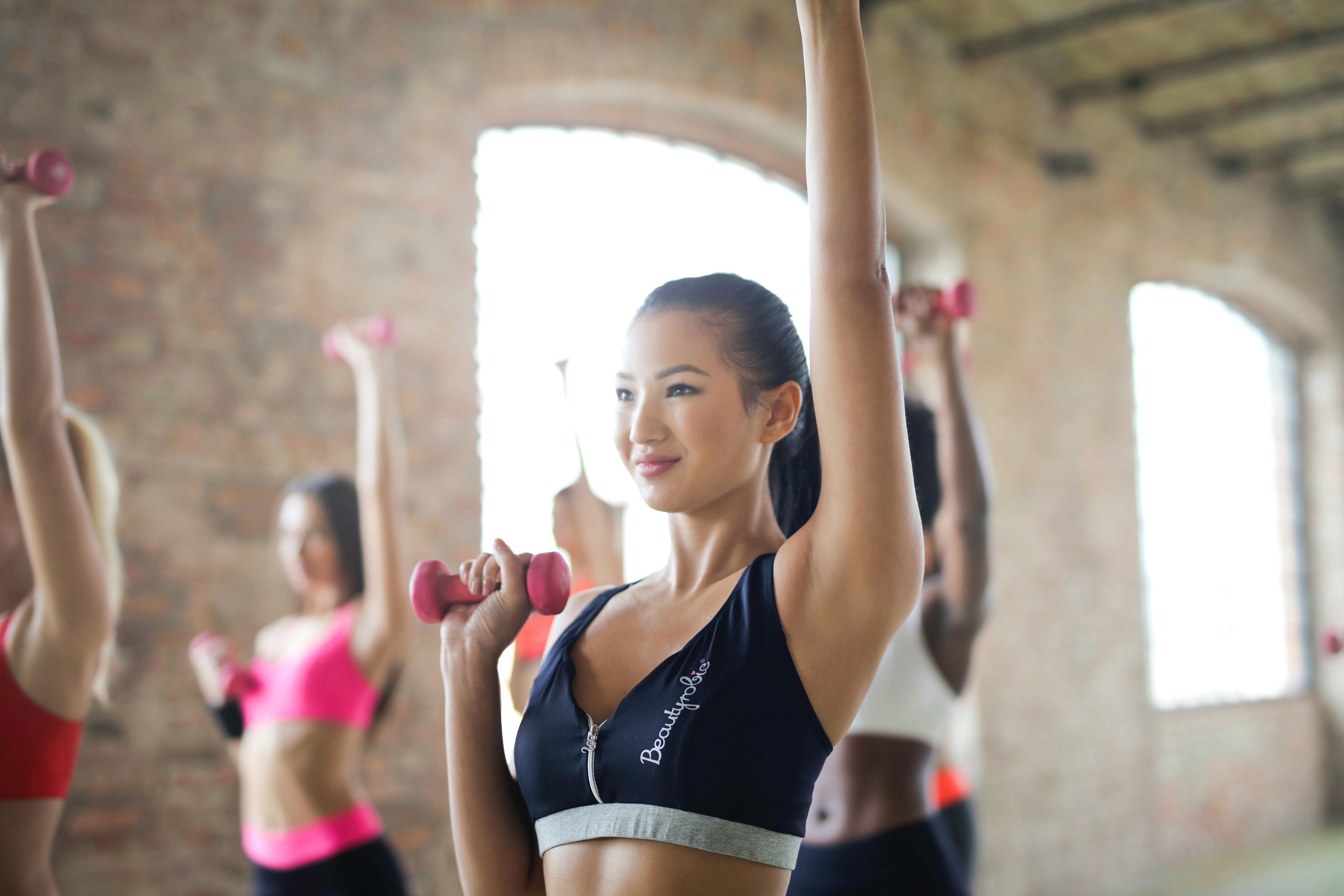 fitness class of women holding a dumbbell