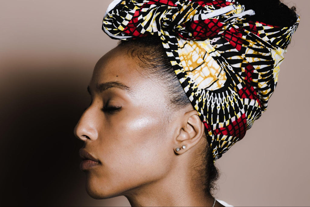 side view of a woman with a wrap on her hair