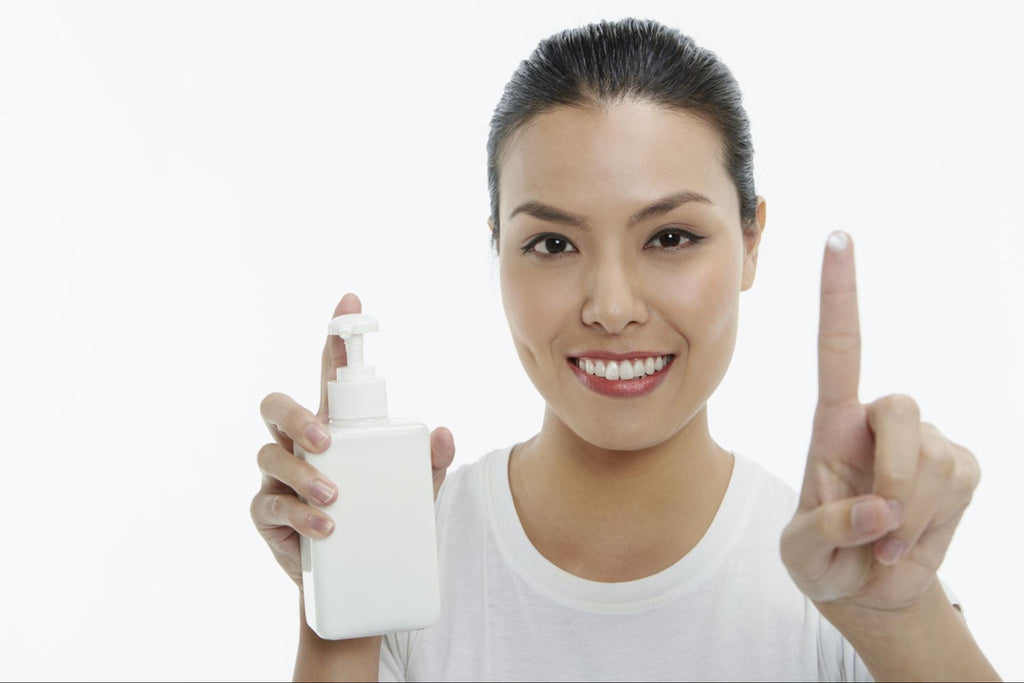 woman holding a lotion