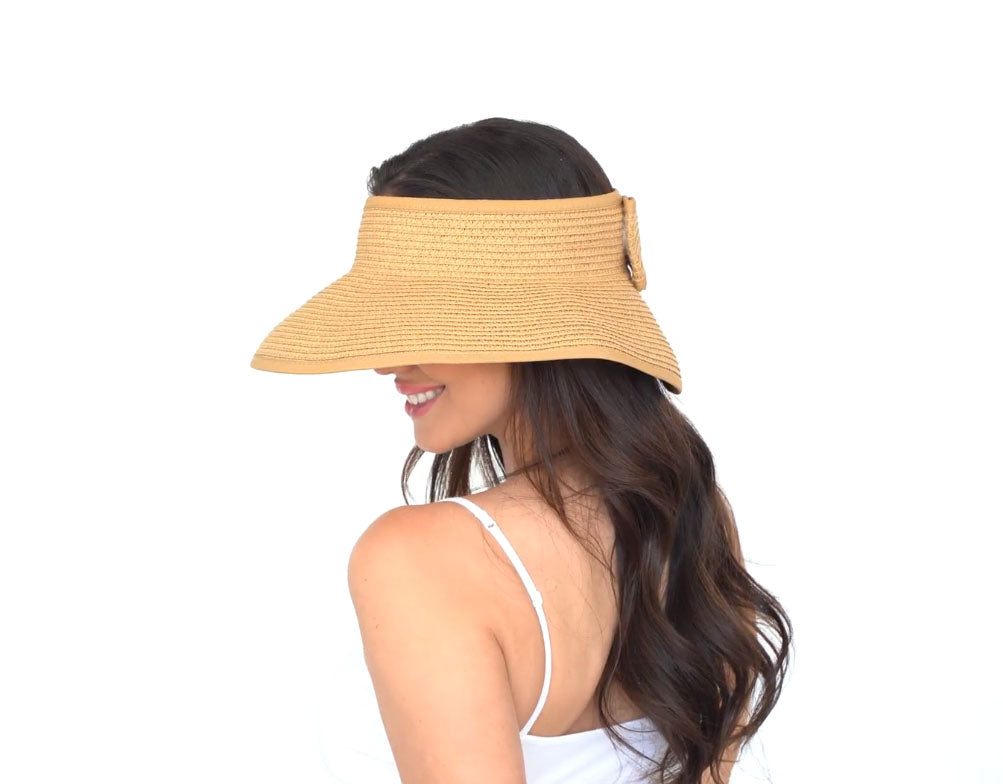 woman with long hair wearing a visor hat