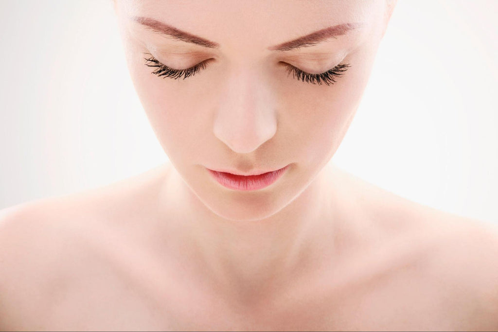 close up look of a woman with close eyes