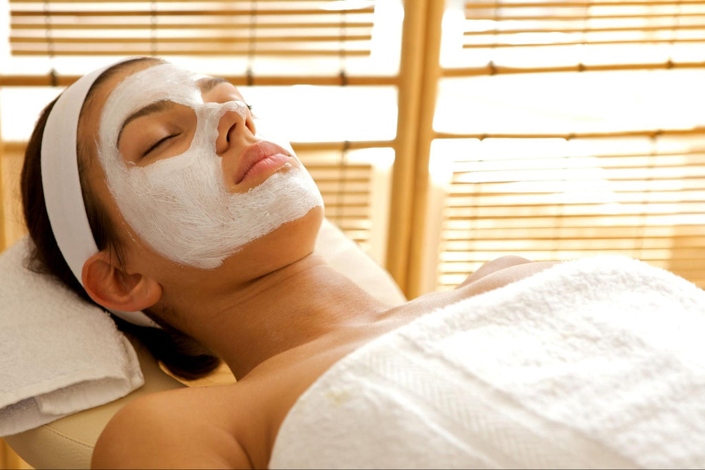 laying woman with a facial mask on