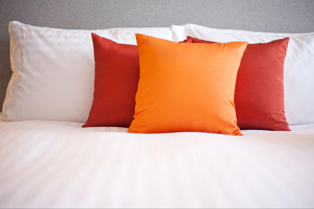 pillowcases on a white bed