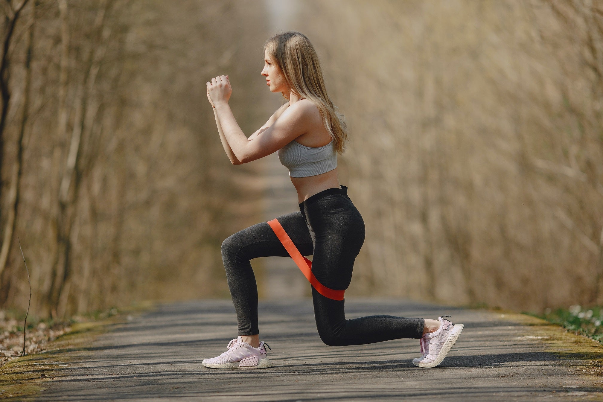 woman exercising using a resistance band