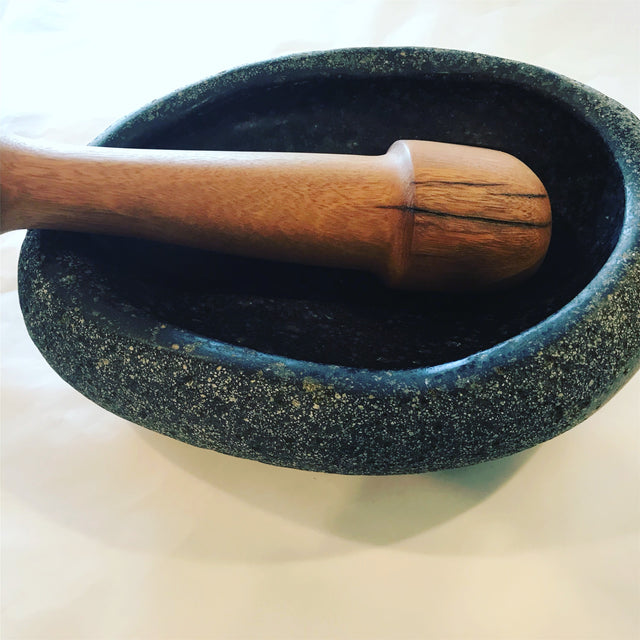 Oblong mortar and pestle