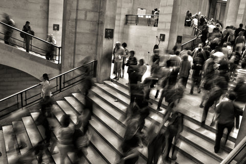 Picture of people on stairs indicating a rushed life