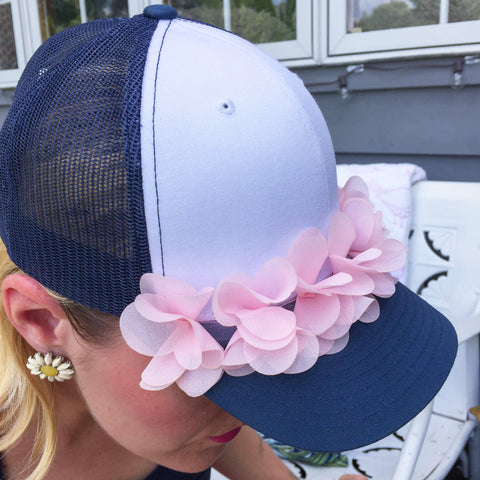 navy and pink trucker hat