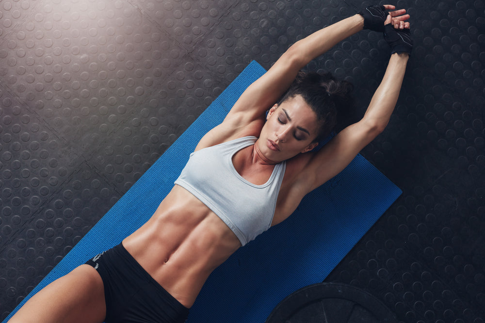woman with strong core laying on mat