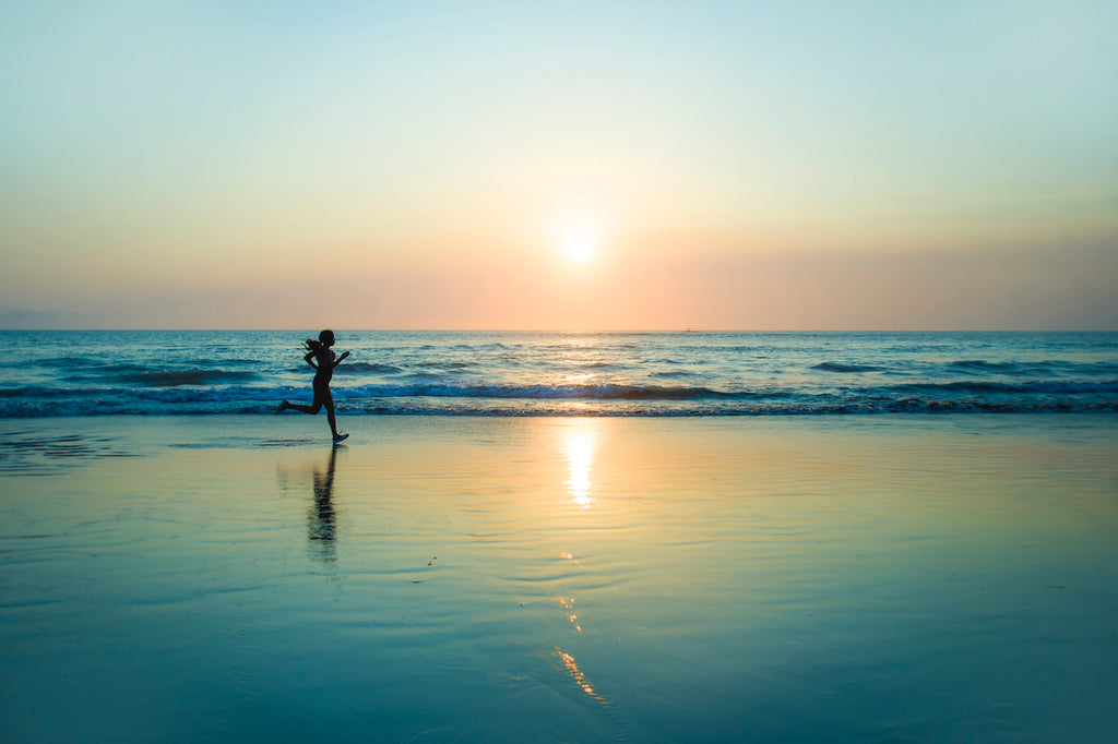 woman running on beach for rest day